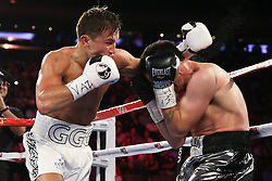 NEW YORK, NY - JULY 26: Gennady Golovkin (white trunks) and Daniel Geale (silver/black trunks) during their WBA/IBO Middleweight World Championship bout at Madison Square Garden on July 26, 2014 in New York, New York. (Photo by Ed Mulholland/K2 Promotions)