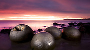 Moeraki Boulders at sunrise. Otago, New Zealand.