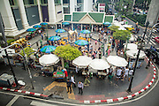 27 SEPTEMBER 2012 - BANGKOK, THAILAND:  An aerial view of the Erawan Shrine in Bangkok. The Erawan Shrine is a Hindu shrine in Bangkok, Thailand, that houses a statue of Phra Phrom, the Thai representation of the Hindu creation god Brahma. A popular tourist attraction, it often features performances by resident Thai dance troupes, who are hired by worshippers in return for seeing their prayers at the shrine answered. The Erawan Shrine was built in 1956 as part of the government-owned Erawan Hotel to eliminate the bad karma believed caused by laying the foundations on the wrong date. The hotel's construction was delayed by a series of mishaps, including cost overruns, injuries to laborers, and the loss of a shipload of Italian marble intended for the building. Furthermore, the Ratchaprasong Intersection had once been used to put criminals on public display. An astrologer advised building the shrine to counter the negative influences. The Brahma statue was designed and built by the Department of Fine Arts and enshrined on 9 November 1956. The hotel's construction thereafter proceeded without further incident. In 1987, the hotel was demolished and the site used for the Grand Hyatt Erawan Hotel.    PHOTO BY JACK KURTZ