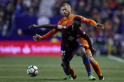 April 19, 2018 - Valencia, Valencia, Spain - Boateng (foreground) of Levante UD competes for the ball with Lacen of Malaga CF during the La Liga game between Levante UD and Malaga CF at Ciutat de Valencia on April 19, 2018 in Valencia, Spain  (Credit Image: © David Aliaga/NurPhoto via ZUMA Press)