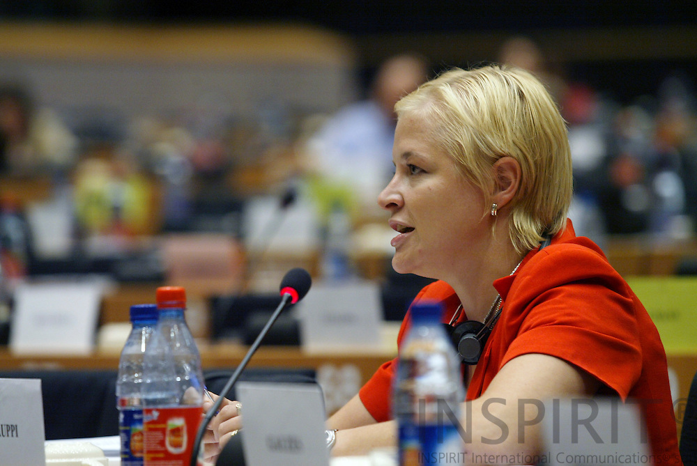 BRUSSELS -BELGIUM - 12 JULY 2006 -- Finnish MEP Piia-Noora KAUPPI sitting the meeting room at the EP during a committee meeting.  PHOTO: ERIK LUNTANG /