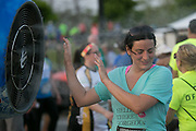 Katie Forget cools off in front of a fan after the Corporate Challenge on the campus of RIT on Tuesday, May 24, 2016.