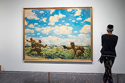 Woman looking at painting  Paratroops Descending on Palembang by Goro Tsuruta at National Museum of  Modern Art  in Tokyo