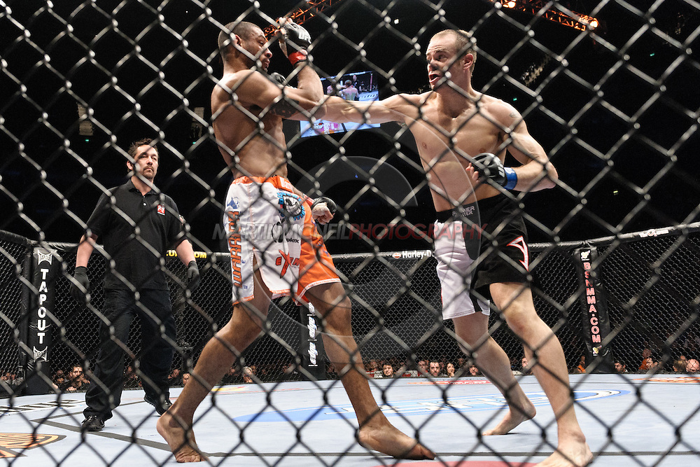 """LONDON, ENGLAND, JUNE 7, 2008: Roan Carneiro (left) attempts to block a punch from Kevin Burns during """"UFC 85: Bedlam"""" inside the O2 Arena in Greenwich, London on June 7, 2008."""