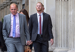 © Licensed to London News Pictures. 08/08/2018. Bristol, UK. England cricketer BEN STOKES (right) arrives at Bristol Crown court with his legal team, for the third day of his trial on charges of affray that relate to a fight outside a Bristol nightclub on September 25 2017. Stokes and two other men, Ryan Ali, 28, and Ryan Hale, 27, all deny the charge. Stokes, Ali and Hale are jointly charged with affray in the Clifton Triangle area of Bristol on September 25 last year, several hours after England had played a one-day international against the West Indies in the city. A 27-year-old man allegedly suffered a fractured eye socket in the incident. Photo credit: Simon Chapman/LNP