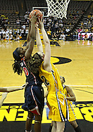 February 24 2011: Illinois Fighting Illini forward Karisma Penn (00) and Iowa Hawkeyes center Morgan Johnson (12) battle for a rebound during the first half of an NCAA women's college basketball game at Carver-Hawkeye Arena in Iowa City, Iowa on February 24, 2011. Iowa defeated Illinois 83-64.