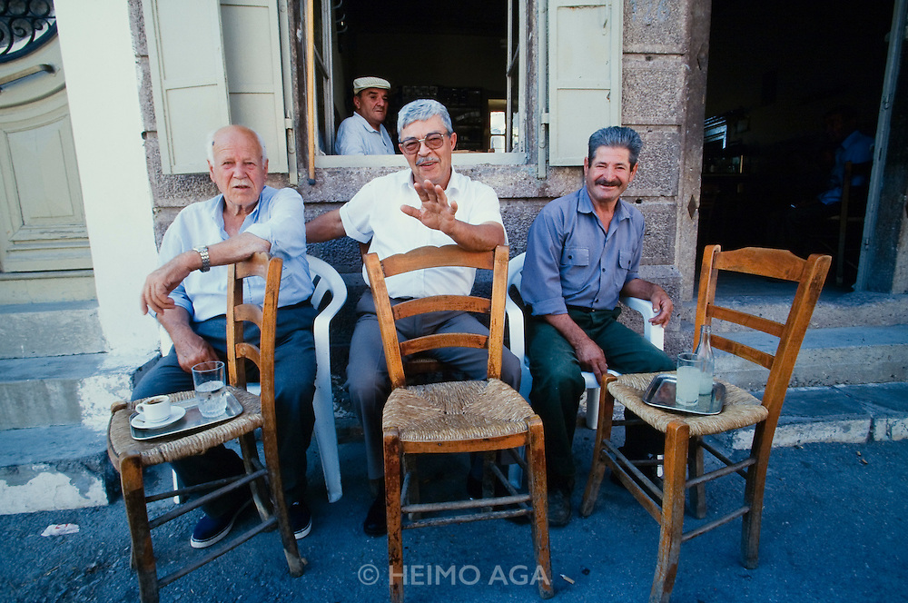 Lisvori. Retired men hanging out at the local Kafenion (coffee shop).