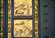 Baptistry building,Florence, Italy, showing two panels of the famous doors by Lorenzo Ghiberti (1378-1455).