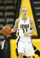 19 February 2009: Iowa guard Kristi Smith (11) brings the ball down court during the first half of an NCAA women's college basketball game Thursday, February 19, 2009, at Carver-Hawkeye Arena in Iowa City, Iowa. Iowa defeated Wisconsin 72-65.
