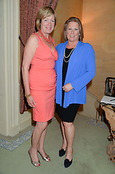 Left to right, FIONA SANDERSON and VISCOUNTESS GORMANSTON at The House of Britannia reception hosted by Lady Delves Broughton at 42 Berkeley Square, London on 26th June 2014.