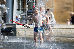 © Licensed to London News Pictures. 13/09/2016. Bradford UK. Children cool of in the water fountains at Millennium Square in Bradford on what is predicted to be be the hottest day in September. Photo credit: Andrew McCaren/LNP
