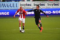 Tromsø 20120823 EUROPA LEAGUE. Tromsø IL - Partizan Beograd, Alfheim Stadion, Tromsø.<br /> Ruben Kristiansen løper fra Mohamed Kamara-Medo