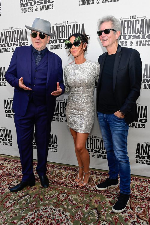 NASHVILLE, TENNESSEE - SEPTEMBER 11: (L-R) Elvis Costello, Amanda Shires and Rodney Crowell arrive at the 18th Annual Americana Honors & Awards at Ryman Auditorium on September 11, 2019 in Nashville, Tennessee. (Photo by Mickey Bernal/Getty Images)