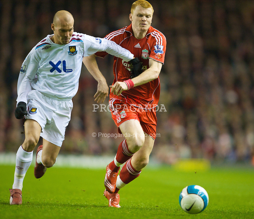 LIVERPOOL, ENGLAND - Wednesday, March 5, 2008: Liverpool's John Arne Riise and West Ham United's Fredrik Ljungberg during the Premiership match at Anfield. (Photo by David Rawcliffe/Propaganda)