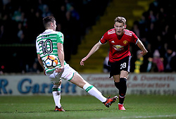 Manchester United's Scott McTominay (right) and Yeovil Town's Jake Gray (left) battle for the ball during the Emirates FA Cup, fourth round match at Huish Park, Yeovil.