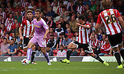 (Carlos) Orlando Sa (Reading striker) seemed to find space in a tight midfield during the Sky Bet Championship match between Brentford and Reading at Griffin Park, London, England on 29 August 2015. Photo by Matthew Redman.