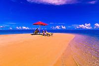 Couple enjoying a private lunch on a secluded sandbar near Nukubati Island Resort, Fiji Islands