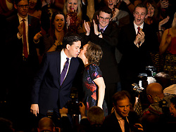© London News Pictures. 24/09/2013 . Brighton, UK.   Labour party leader ED MILIBAND and wife JUSTINE THORNTON kiss on stage after delivering his Key-note speech on the third day of the Labour Party Conference in Brighton. Photo credit : Ben Cawthra/LNP