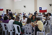 People enjoying a Chilean themed lunch social event at Missao Paz, São Paulo, Brazil.<br /> <br /> Missao Paz provides advice and support on employment, health, family, community and education. They also have residential quarters where people can stay when they have no where else. <br /> <br /> Their mission is to welcome, understand, integrate and celebrate the lives of immigrants and refugees, dreaming of a universal citizenship.