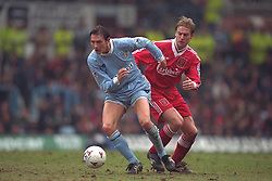 COVENTRY, ENGLAND - Saturday, April 6, 1996: Liverpool's John Scales in action against Coventry City's Noel Whelan during the Premiership match at Highfield Road. Coventry won 1-0. (Pic by David Rawcliffe/Propaganda)