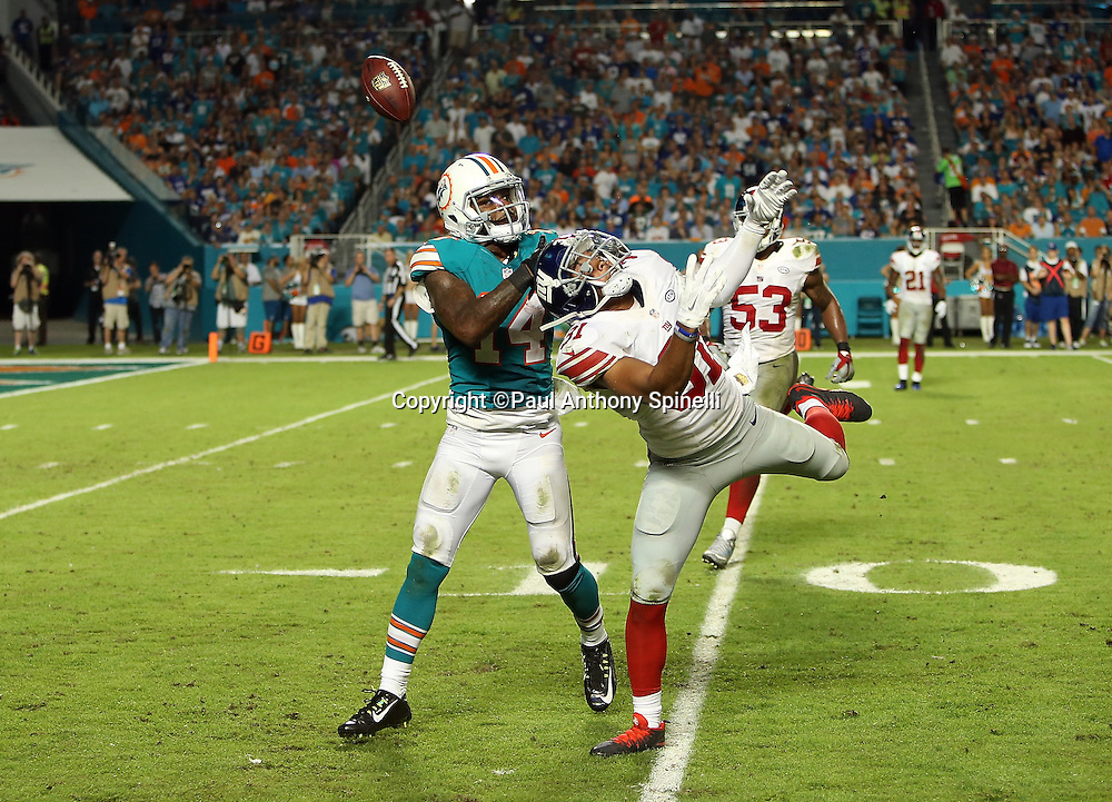 New York Giants defensive back Trevin Wade (31) breaks up a deep pass intended for Miami Dolphins wide receiver Jarvis Landry (14) in the fourth quarter during the NFL week 14 regular season football game against the Miami Dolphins on Monday, Dec. 14, 2015 in Miami Gardens, Fla. The Giants won the game 31-24. (©Paul Anthony Spinelli)