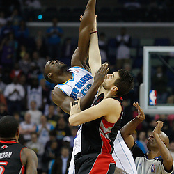 January 17, 2011; New Orleans, LA, USA; New Orleans Hornets center Emeka Okafor (50) and Toronto Raptors center Andrea Bargnani (7) jump for the opening tip of the first quarter at the New Orleans Arena.   Mandatory Credit: Derick E. Hingle
