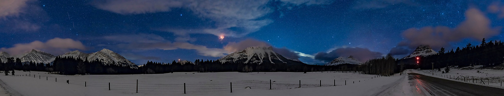 A panorama of the total eclipse of the Moon on January 31, 2018 from the Crowsnest Pass area of the Alberta Rocky Mountains near the Continental Divide. Crowsnest Mountain itself is at far right. Cassiopeia is just above Crowsnest Mountain. Gemini is just setting right of centre.<br /> <br /> This was about 6:33 am MST, just after mid-totality, but with the Moon still in some cloud, as it typically was this morning. <br /> <br /> This was from near Coleman, Alberta. <br /> <br /> The panorama is from 8 segments, each with the 35mm lens at f/2.8 for 15 seconds at ISO 1600 with the Canon 6D MkII. Stitching was with Adobe Camera Raw. <br /> <br /> The Moon itself is blend of 4 exposures: 15 seconds, 4 seconds, 1 second, and 1/4 second to retain the red disk of the eclipsed Moon while bringing out the stars in the twilight sky. This was looking west as the Moon was setting.