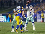 Jan 12, 2019; Los Angeles, CA, USA; Dallas Cowboys quarterback Dak Prescott (4) throws a pass against the Los Angeles Rams during an NFL divisional playoff game at the Los Angeles Coliseum. The Rams beat the Cowboys 30-22. (Kim Hukari/Image of Sport)