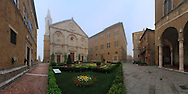 Piazza Pio II (Pius II Square) is the key point of the beautiful renaissance town of Pienza in Tuscany, Italy, declared world heritage site in 1996 by Unesco. Pienza was rebuilt from a village called Corsignano, which was the birthplace (in 1405) of Enea Silvio Piccolomini, a Renaissance humanist who later became Pope Pius II. Once he became Pope, Piccolomini had the entire village rebuilt as an ideal Renaissance town. Intended as a retreat from Rome, it represents the first application of humanist urban planning concepts, creating an impetus for planning that was adopted in other Italian towns and cities and eventually spread to other European centers. All the most important building of the town have their facade on the square. From left to right: Palazzo Vescovile, the Bishop's Palace:  the Duomo (Cathedral); Palazzo Piccolomini, Pius II's own residence; and finally, on the far right, the colonnade of Palazzo Comunale, the Town Hall. Taken on a cold, foggy morning at the beginning of May, this is stitched from seven vertical frames.