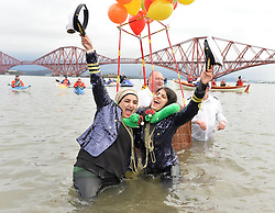 nearly a thousand brave souls took to the freezing waters of the Firth of Forth in Queensferry, Scotland, for the annual Loony Dook swim on January 1st.<br /> <br /> &copy; Dave Johnston/ EEm