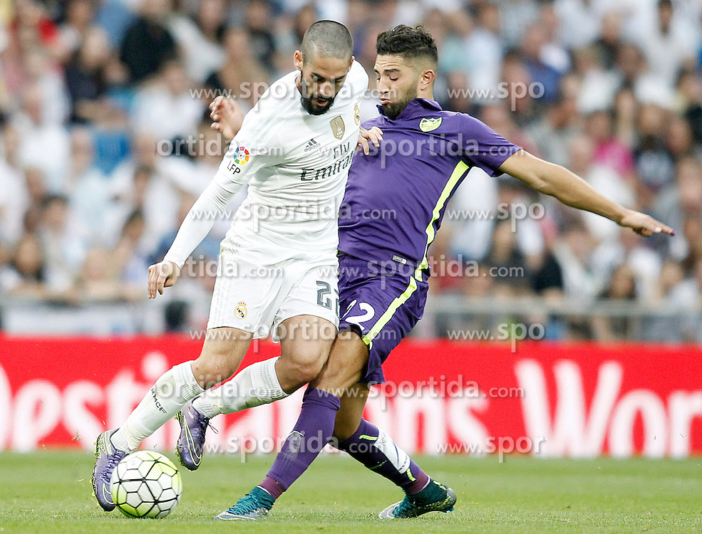 26.09.2015, Estadio Santiago Bernabeu, Madrid, ESP, Primera Division, Real Madrid vs Malaga CF, 6. Runde, im Bild Real Madrid's Isco (l) and Malaga's Adnane Tighadouini // during the Spanish Primera Division 6th round match between Real Madrid and Malaga CF at the Estadio Santiago Bernabeu in Madrid, Spain on 2015/09/26. EXPA Pictures &copy; 2015, PhotoCredit: EXPA/ Alterphotos/ Acero<br /> <br /> *****ATTENTION - OUT of ESP, SUI*****