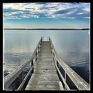 Bridgehampton, NY-- November 2, 2013:  The dock of a Bridgehampton home on Dune Road provides an inviting approach to Mecox Bay.  ©Audrey C. Tiernan