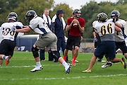 Stephenville High School quarterback Jarrett Stidham drops back to pass during practice in Stephenville, Texas on November 5, 2013. (Cooper Neill / for The New York Times)