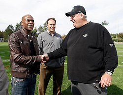 "October 8, 2009; Florham Park, NJ; USA; Floyd ""Money"" Mayweather (l) greets New York Jets head coach Rex Ryan (r) while Jets GM Mike Tannenbaum looks on."