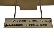 Sign with arrows pointing to New York and to Point East, on elevated platform of Merrick train station of Babylon branch, after MTA Metropolitan Transit Authority and Long Island Rail Road union talks deadlock, with potential LIRR strike looming just days ahead.