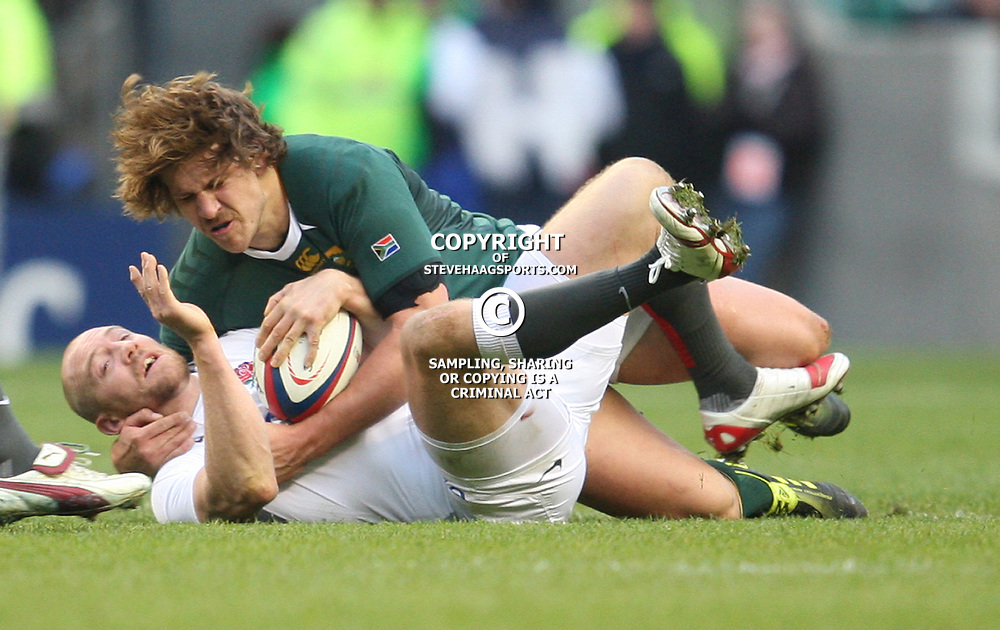 LONDON, ENGLAND - NOVEMBER 27, Frans Steyn tackles Mike Tindall during the End of Year tour match between England and South Africa at Twickenham Stadium on November 27, 2010 in London, England<br /> Photo by Steve Haag / Gallo Images