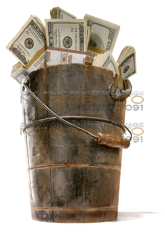 cash money in a bucket photographed on a white background