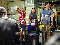 April 13, 2018 - Bangkok, Bangkok, Thailand - Thais throw water on tourists during a water fight on Silom Road on the first day of Songkran in Bangkok. Songkran is the traditional Thai New Year celebration best known for water fights. (Credit Image: © Jack Kurtz via ZUMA Wire)