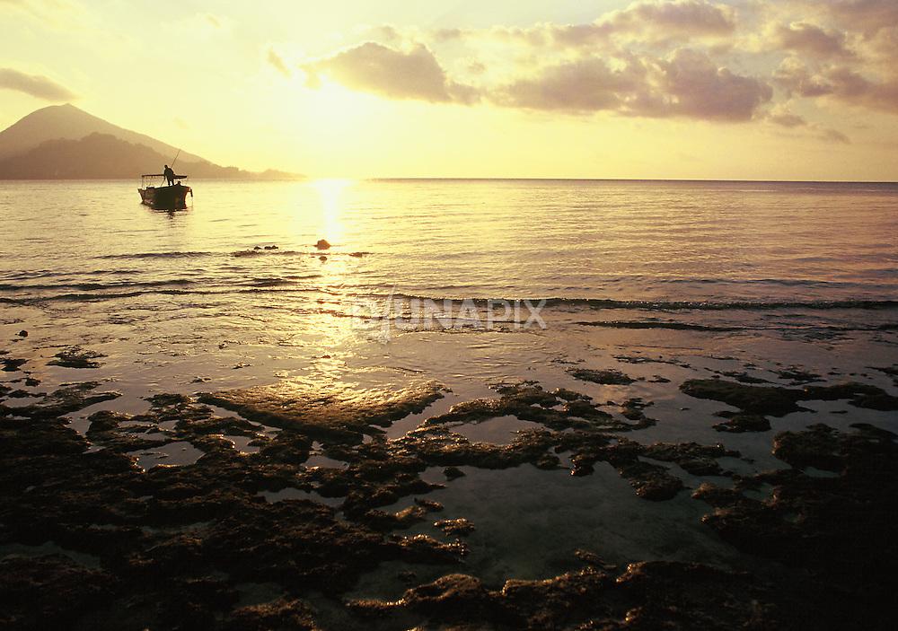 Sunset at Pulau Pisang, Banda Archipelago, Maluku, Indonesia