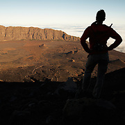 Woman enjoying the view while climbing  Pico Fogo, Fogo Island, Cape Verde, West Africa.