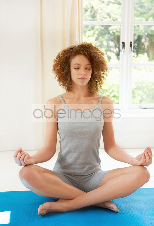 Woman Practicing Yoga in the Easy Pose