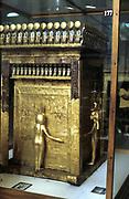Golden outer sarcophagus of Tutenkamen (Tutankhamun) dc1340BC with guardian figures. Ancient Egyptian Pharaoh