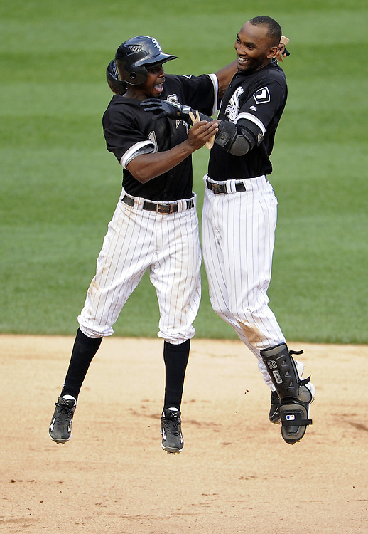 CHICAGO - JULY 09:  Juan Pierre #1 (L) and Alexei Ramirez #10 of the Chicago White Sox celebrate after Ramirez drove in the game winning run in the bottom of the ninth inning against the Minnesota Twins on July 9, 2011 at U.S. Cellular Field in Chicago, Illinois.  The White Sox defeated the Twins 4-3.  (Photo by Ron Vesely)  Subject: Juan Pierre;Alexei Ramirez.