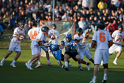 Johns Hopkins midfielder Paul Rabil (9) is upended by Virginia defenseman Mike Timms (44).  The #2 ranked Virginia Cavaliers defeated the #6 ranked Johns Hopkins Blue Jays 13-12 in overtime at the University of Virginia's Klockner Stadium in Charlottesville, VA on March 22, 2008.  The loss, in front of a record UVA crowd of 7,500, was the third consecutive overtime defeat for Hopkins, the defending national champions.