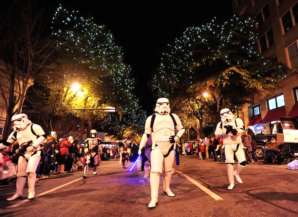Members of the 501st Legion of Stormtroopers, a Star Wars Imperial costuming club, storm down the streets of downtown Athens during the annual Downtown Parade of Lights on Thursday, Dec. 2, 2010 in Athens, Ga. .