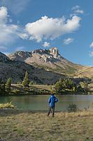 Adult male relaxing along bank of Sun River, Castle Reef Mountain ,Sun Canyon Montana