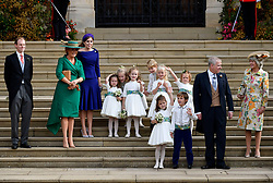 Sarah, Duchess of York and Princess Beatrice, Duke of York, Thomas Brooksbank, the bridesmaids and page boys, including Prince George and Princess Charlotte, leave after the wedding of Britain's Princess Eugenie of York and her husband Jack Brooksbank at St George's Chapel in Windsor Castle.