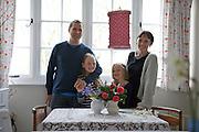 The Elliott family in their dining room. From left to right: Richard Elliott, Molly Elliott (10), Milly-grace (8), Tracey Elliott. Pickwell Manor, Georgeham, North Devon, UK.<br /> CREDIT: Vanessa Berberian for The Wall Street Journal<br /> HOUSESHARE