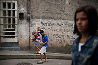 "Vidigal, a pacified favela in the South Zone, has become a popular community for new businesses and foreigners to live, Rio de Janeiro, Brazil, on Thursday, May 23, 2013. The writing on the wall says, ""for sale,"" with contact information."