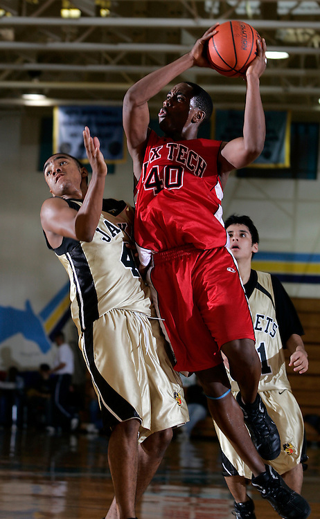 McAllen, TX / 2005 - San Antonio Fox Tech's Rashad Johnson (#40) drives to the hoop against Edcouch-Elsa defender B.J. Rowell during their City of Palms Hoop Tournament game at McAllen Memorial High School Friday afternoon. Photo by Mike Roy / The Monitor